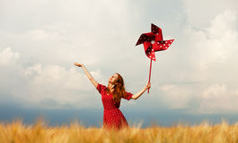 Girl with toy wind turbine Stock Photography