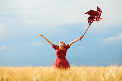 Girl with toy wind turbine Stock Photo
