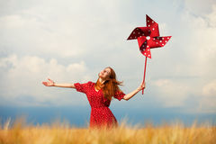 Girl with toy wind turbine Stock Images