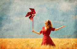 Girl with toy wind turbine Royalty Free Stock Photos