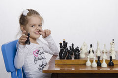 Girl toying playing chess Stock Photography