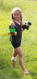 Girl with toys Stock Images