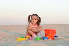 Girl with toys on the beach Stock Photo