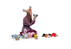 Girl and toys, hat with horns Stock Photos