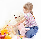 The girl with toys Royalty Free Stock Photography