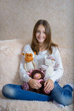 Girl and toys Royalty Free Stock Image