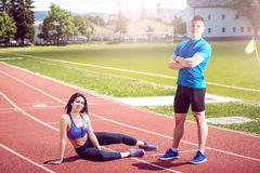 Girl on track with her personal trainer. Royalty Free Stock Images