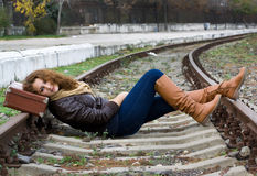 Girl on the tracks Stock Photography