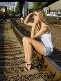Girl on tracks Royalty Free Stock Image