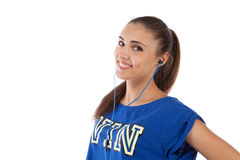 Girl in tracksuit listening to music Stock Photography