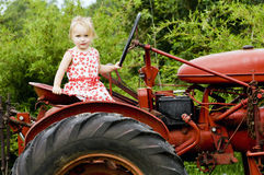 Girl on Tractor Royalty Free Stock Photography