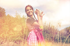 Girl in traditional bavarian dirndl holds beer mug Stock Photography