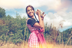 Girl in traditional bavarian dirndl holds beer mug Royalty Free Stock Photography