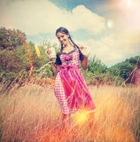 Girl in traditional bavarian dirndl holds beer mug Royalty Free Stock Photos
