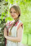 Girl in traditional clothes Stock Photo
