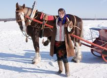 Girl in traditional clothes and horse-drawn stock image