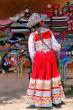 Girl in traditional dress standing at the market in Maca village Royalty Free Stock Photo