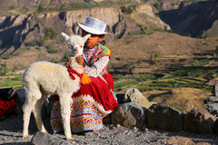 Girl in traditional dress standing at the market in Maca village Stock Photography