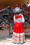 Girl in traditional dress standing at the market in Maca village Royalty Free Stock Images