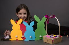 Girl traditional easter bunnies. Happiness positive tradition celebration isolated on silver Royalty Free Stock Photos