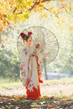 Girl in traditional Japanese kimono Stock Photos
