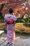 Girl in traditional Kimono in kanazawa garden in autumn. stock photo