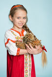 Girl in a traditional Russian costume with pine cones Stock Photography
