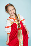 Girl in traditional Russian folk costume. Girl seven years stock image