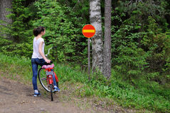 Girl and traffic sign. Royalty Free Stock Photography