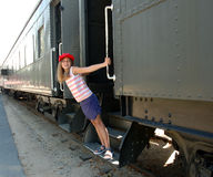 Girl and train 1. Girl leaning out of train Royalty Free Stock Photo
