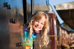 Girl on train. A cute girl looking out from a train window Royalty Free Stock Photos
