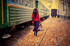 Girl in train. Beautiful young woman near a train Stock Image