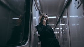 The girl in the train car uses a smartphone stock footage
