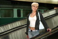 Girl at a train station Royalty Free Stock Photography