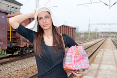 Girl on the train station Royalty Free Stock Images