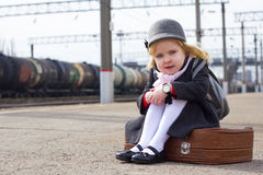 Girl at the train station Royalty Free Stock Images
