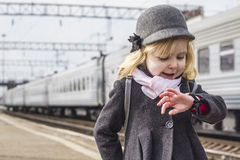 Girl at the train station Royalty Free Stock Image