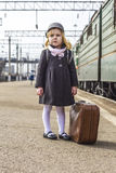 Girl at the train station Stock Image