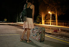 Girl at train station during night wide Royalty Free Stock Photography