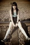 Girl on the train tracks Royalty Free Stock Images