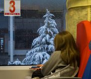 Girl on a train in winter. Iphone Royalty Free Stock Photo