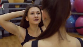 Girl and trainer engaged in fitness room, slow motion. stock footage