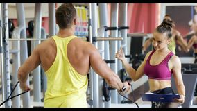 Girl trainer looks for men stock footage
