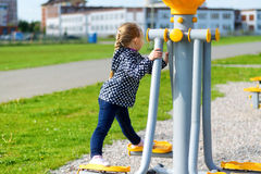 Girl on trainer in spring park. Girl on outdoor trainer in spring park Stock Images