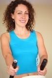 Girl on training apparatus. Smiling girl on training apparatus Stock Photo