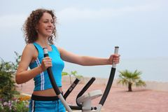Girl on training apparatus outdoor Royalty Free Stock Image