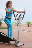 Girl on training apparatus outdoor Royalty Free Stock Photography