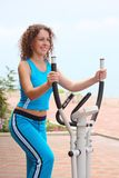 Girl on training apparatus outdoor Stock Image