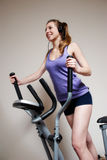 Girl on training apparatus  in sportclub Stock Photography