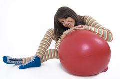 Girl with training ball. Pretty girl with ball for training Royalty Free Stock Image